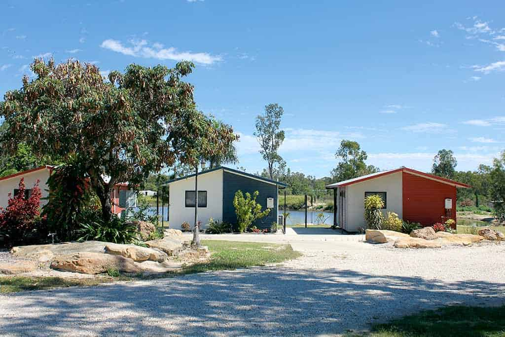 A scenic image of cabins at Anakie Caravan Park in the Gemfields