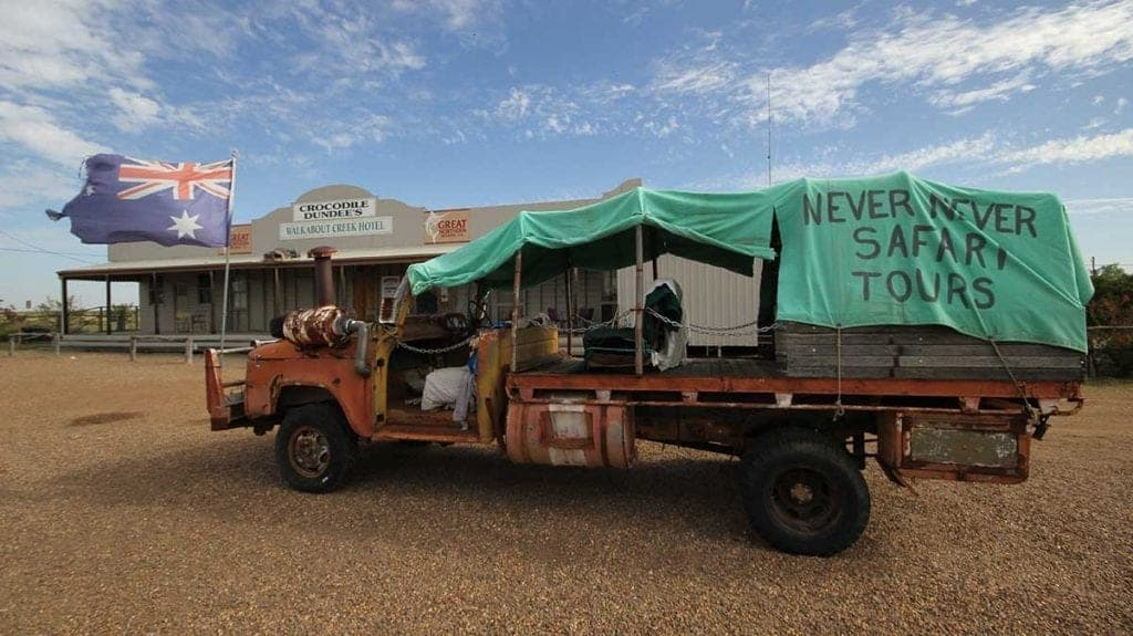 Never Never Safari Tours bus from the movie Crocodile Dundee parked in front of the Walkabout Creek Hotel