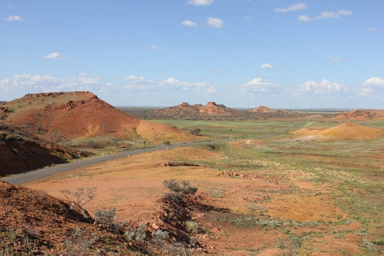 Landscape shot of several mesas breaking up the flat land